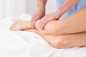 Physical therapist doing lymphatic drainage for the legs